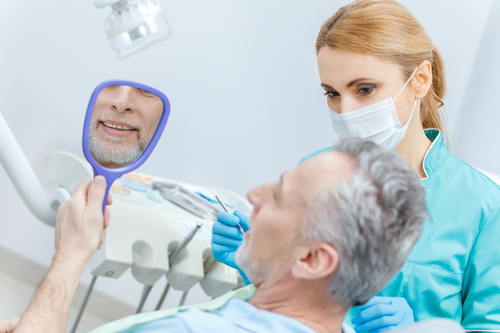 man at dentist for oral cancer check