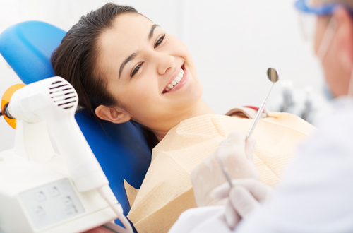Woman having dental cleaning