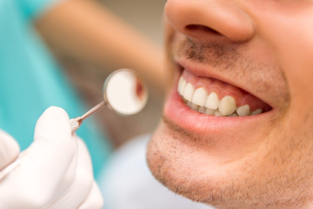 man with gum disease getting teeth clean